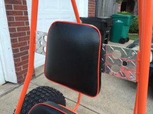 head rest with orange piping and diamond plate
